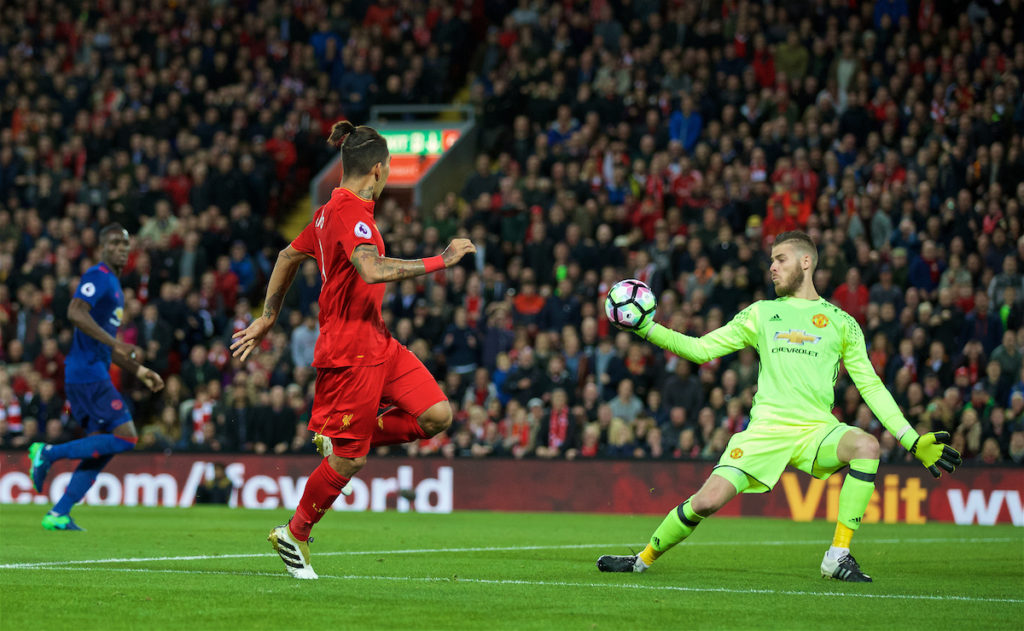 October 17, 2016: Manchester United's goalkeeper David de Gea makes a save from Liverpool's Roberto Firmino during the FA Premier League match at Anfield.